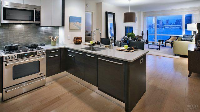 Кухня в современном интерьере квартиры-студии
