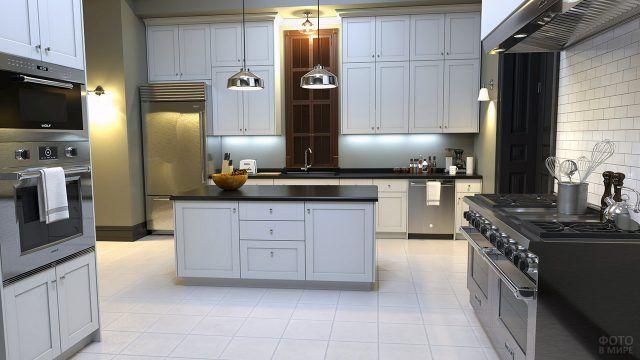 Просторная кухня с тёмными столешницами в белом интерьере