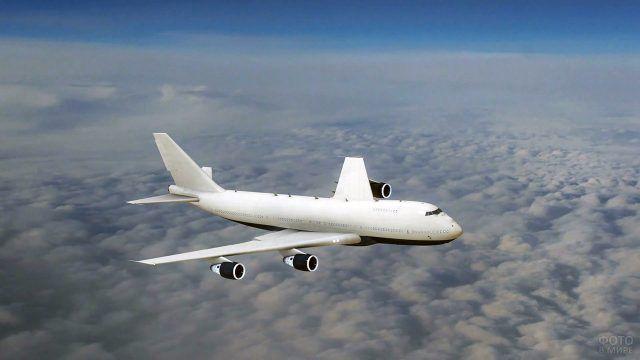 Белоснежный пассажирский лайнер над облаками
