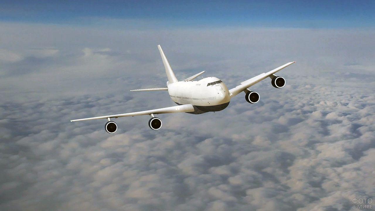 Пассажирский самолёт над облаками