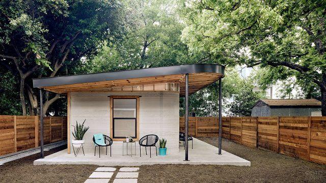 Современный садовый домик с верандой под плоской крышей