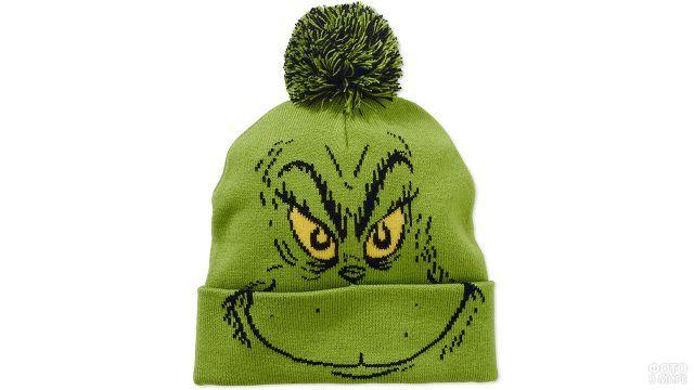 Зелёная вязаная шапка с мульт-персонажем и помпоном