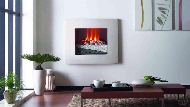 Электрический камин-картина в светлом современном интерьере