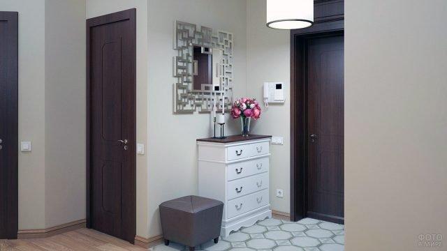 Дизайн прихожей в стиле минимализм с белым комодом и тёмными дверьми