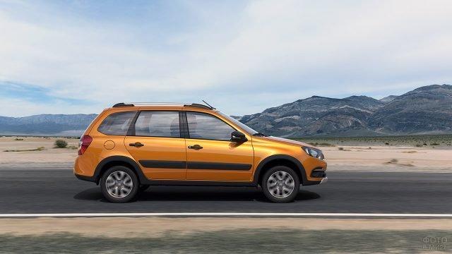 Оранжевая Лада Гранта универсал в профиль на горной дороге