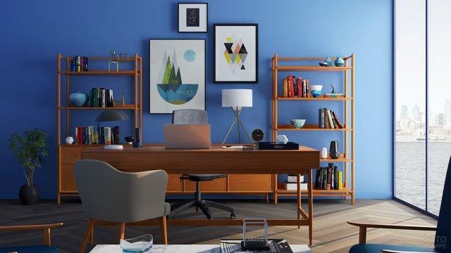 Рабочий кабинет с ярко-синей стеной и мебелью в скандинавском стиле