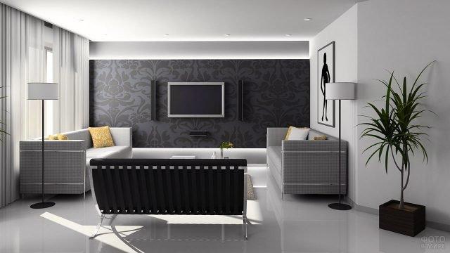 Стильная чёрно-белая гостиная с домашним кинозалом на контрастной стене