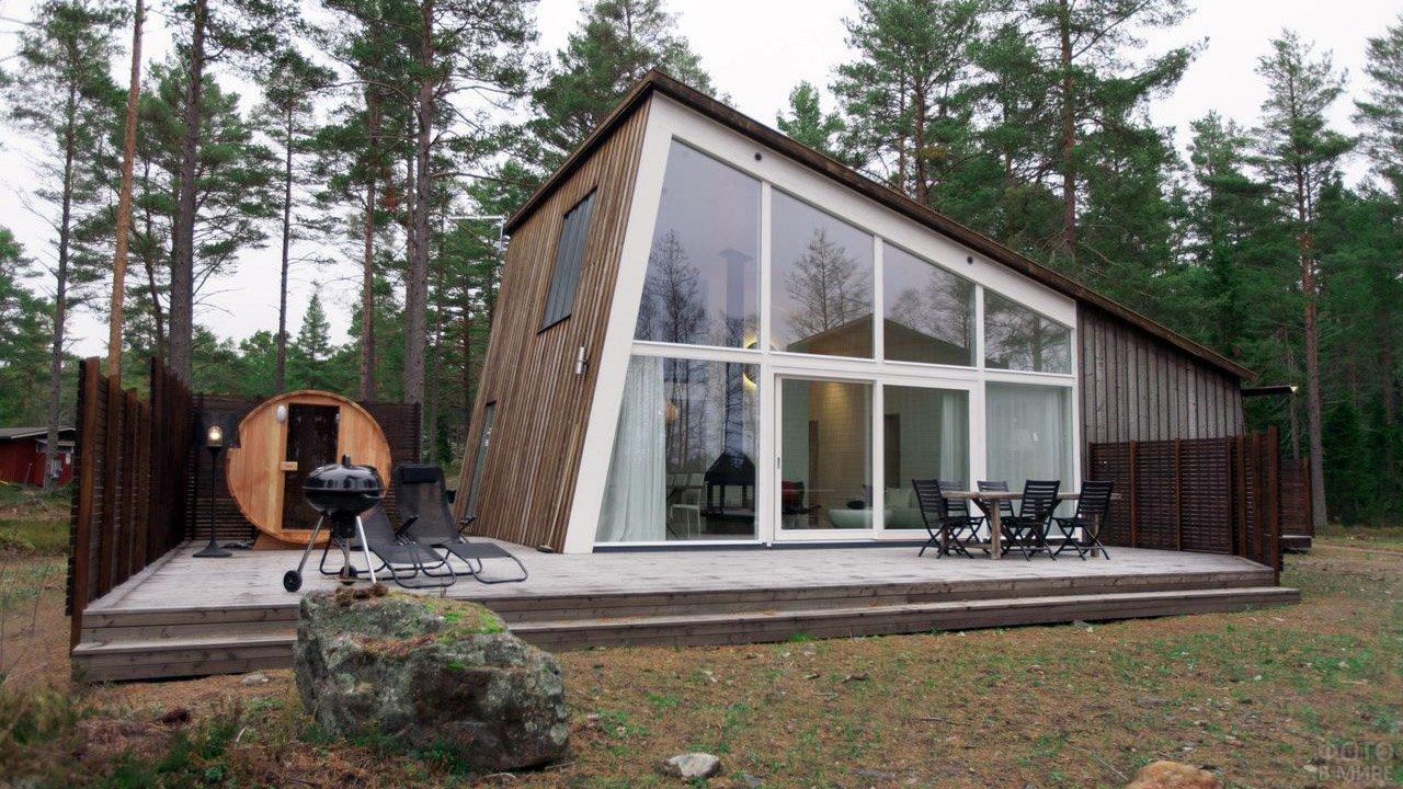 Современный скандинавский домик с площадкой для барбекю