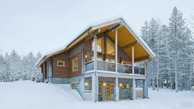 Гостевой деревянный дом в зимней Финляндии