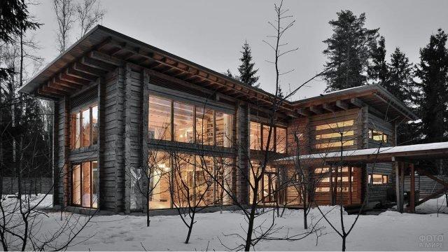 Загородный прямоугольный бревенчатый дом в современном стиле с французским остеклением