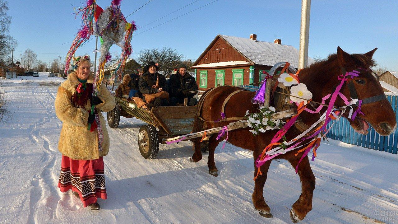 Ряженые в телеге рождественским утром в селе Южной Осетии