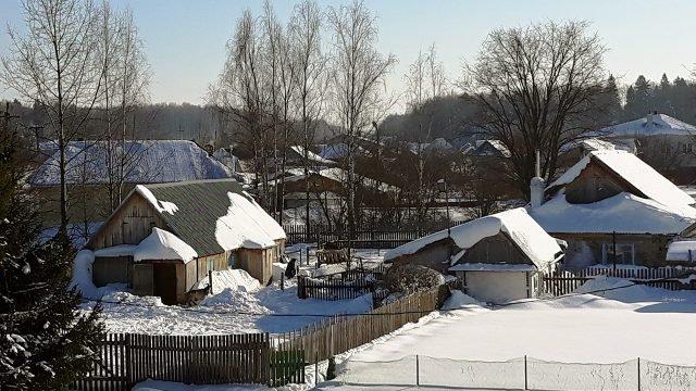 Утро в заснеженной деревеньке