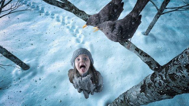 Девочка ловит снежинки ртом под веткой с птицами