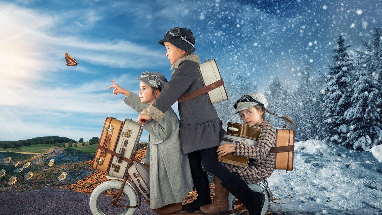 Девочки с чемоданами на велосипеде