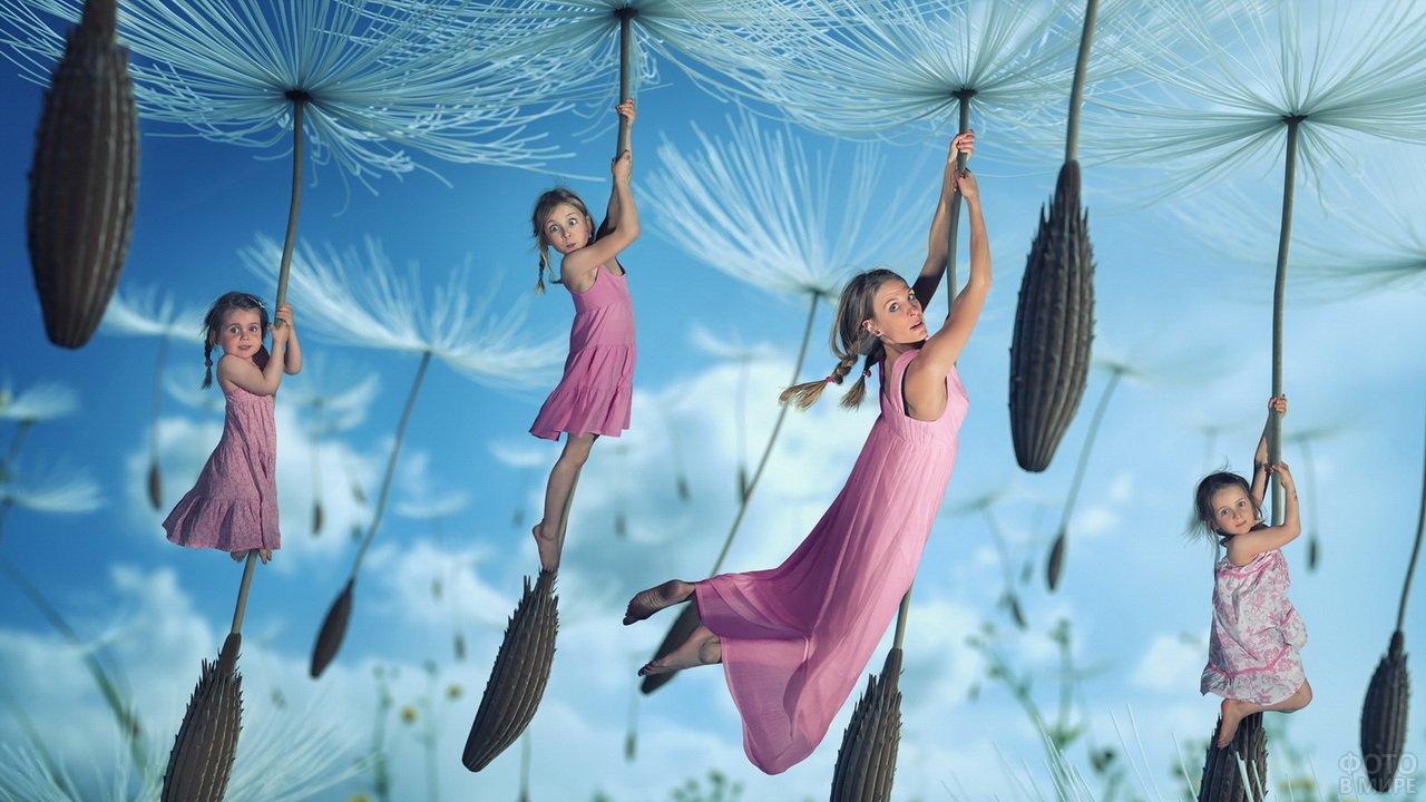 Мама с тремя дочками летят на зонтиках одуванчиков