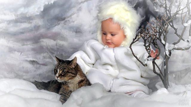 Ребёнок и кошка зимой