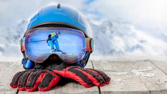 Отражение сноубордиста в защитных очках