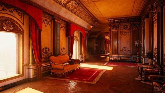 Красная софа между окнами в интерьере замка