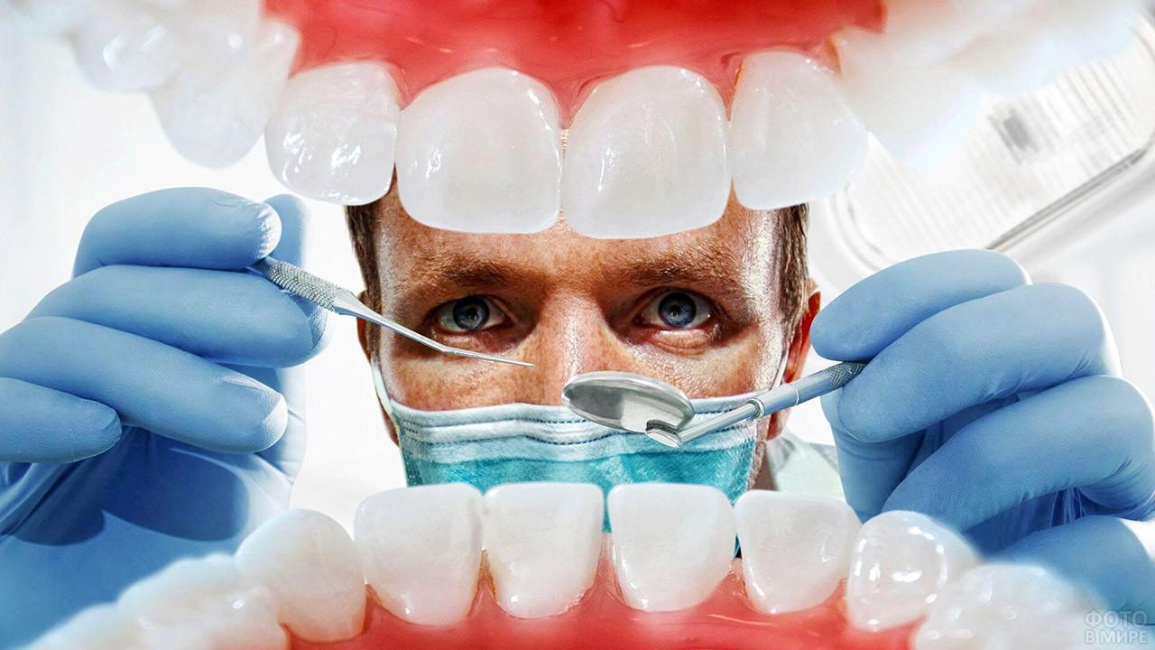 Белоснежные зубы на фоне стоматолога с инструментами