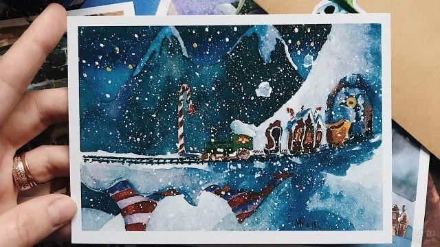 Акварельная рождественская открытка в руке автора