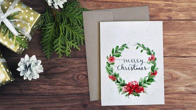 Акварельный венок на рождественской открытке