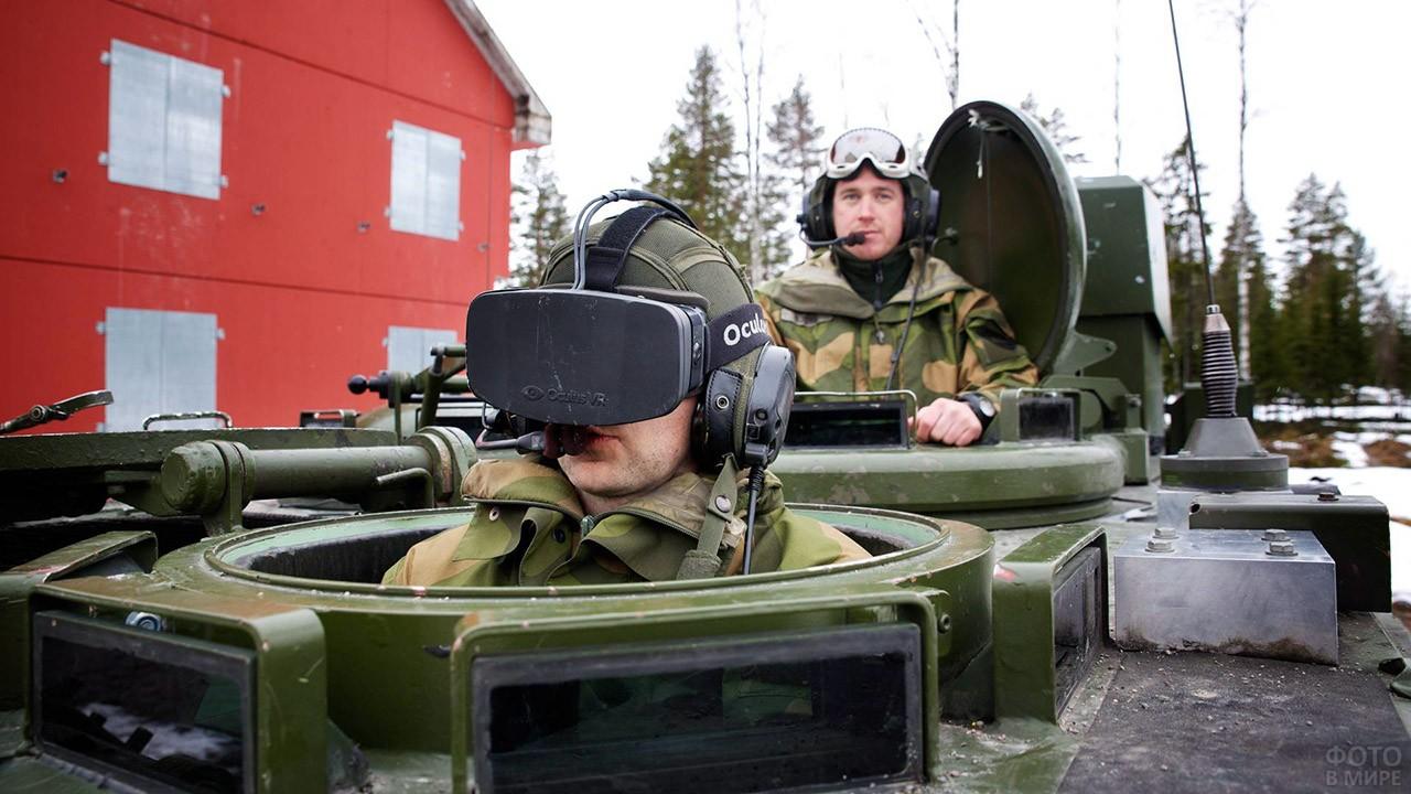 Современные танкисты в башне танка