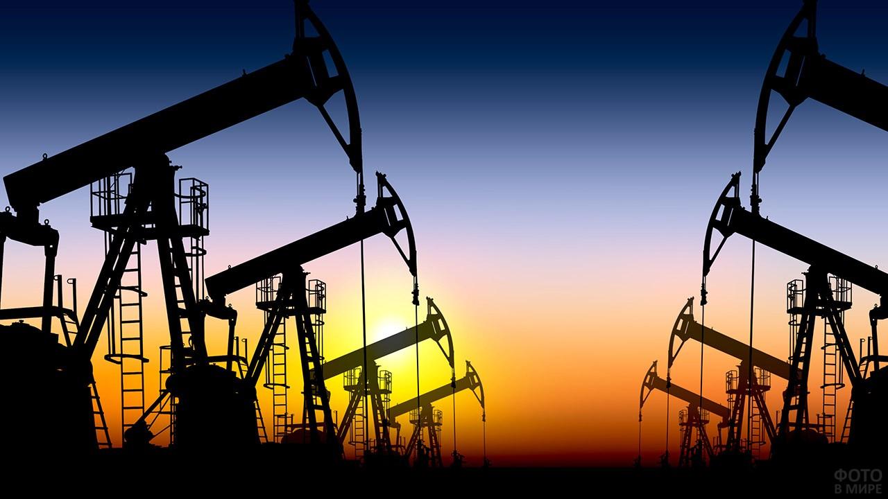 Аллея нефтяных вышек на фоне заката