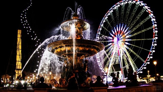 Фонтан и колесо обозрения на площади Согласия