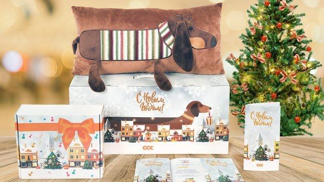 Корпоративные подарки к Новому году оформленные в одном стиле с нарисованной таксой