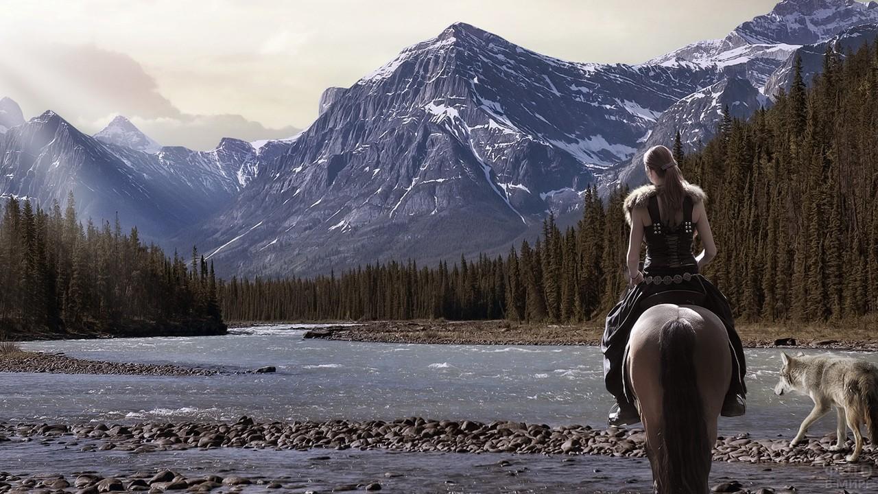 Девушка в горах верхом на лошади